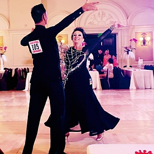 Happy woman with ballroom dance partner